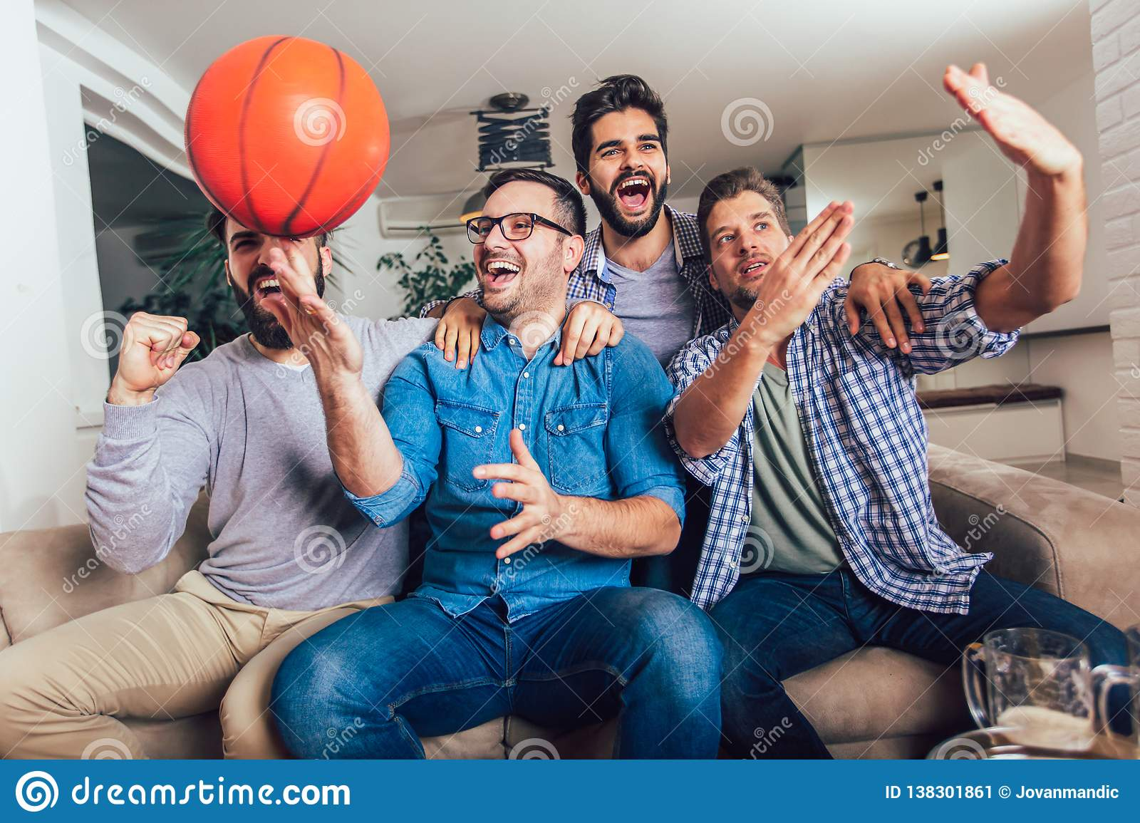 Happy Friends Or Basketball Fans Watching Basketball Game On Tv And Celebrating Victory At Home Stock Image Image Of Fans Background 138301861