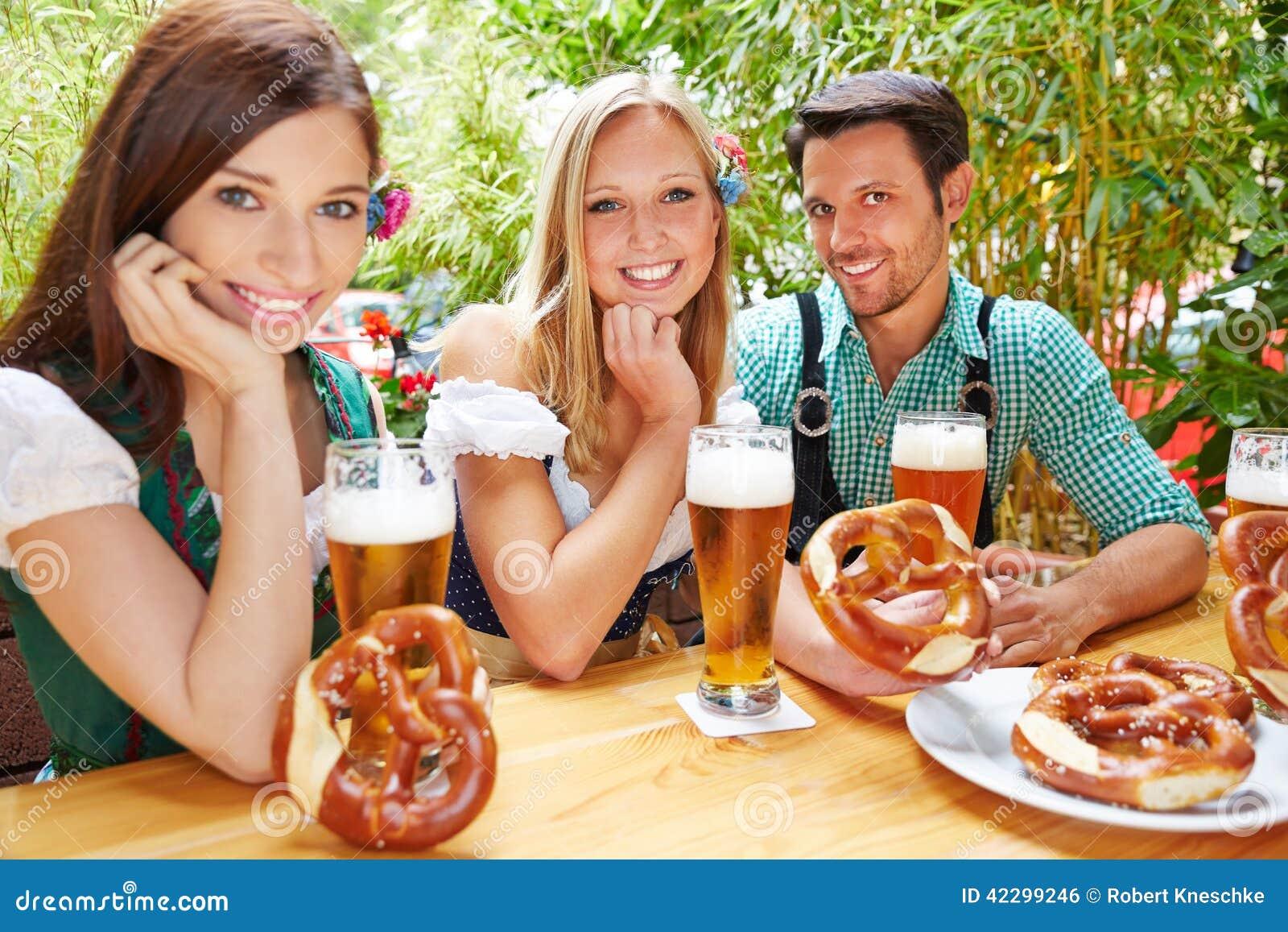 Happy friends in beer garden