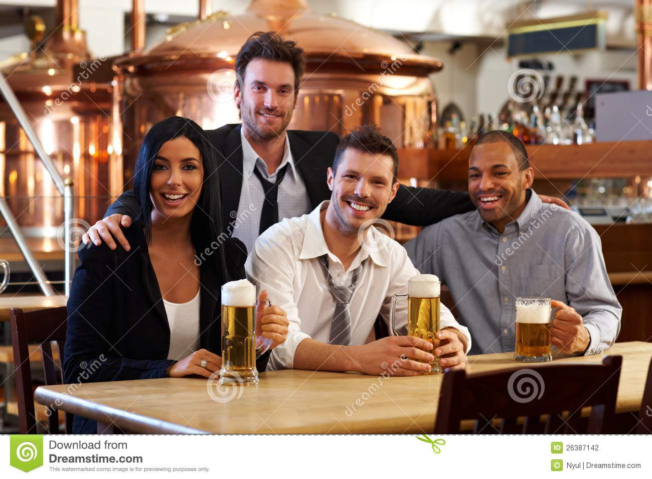 happy friends drinking beer at pub stock photography