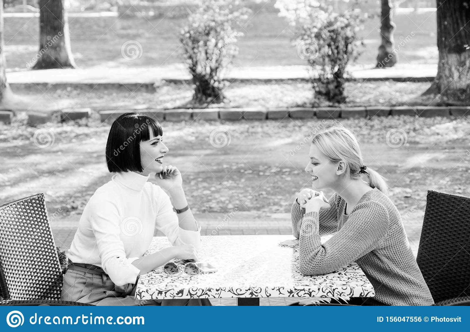 Happy friends girls spend time in cafe. real female frienship. family bonding sisterhood. bisiness meeting. free time