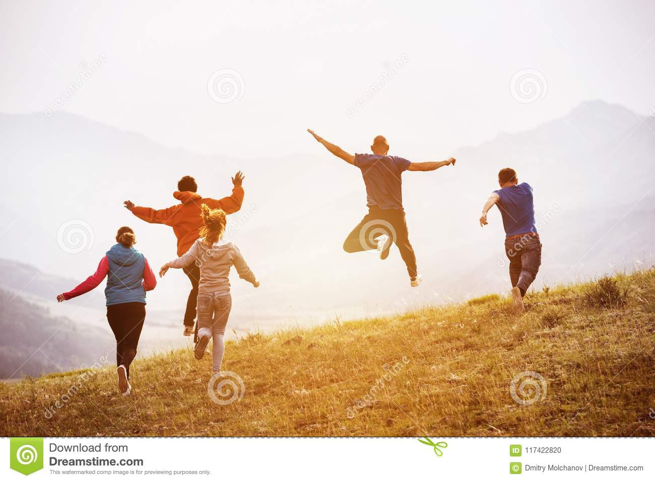 31f439973b905 Happy Friends Runs And Jumps Outdoors Stock Photo - Image of journey ...
