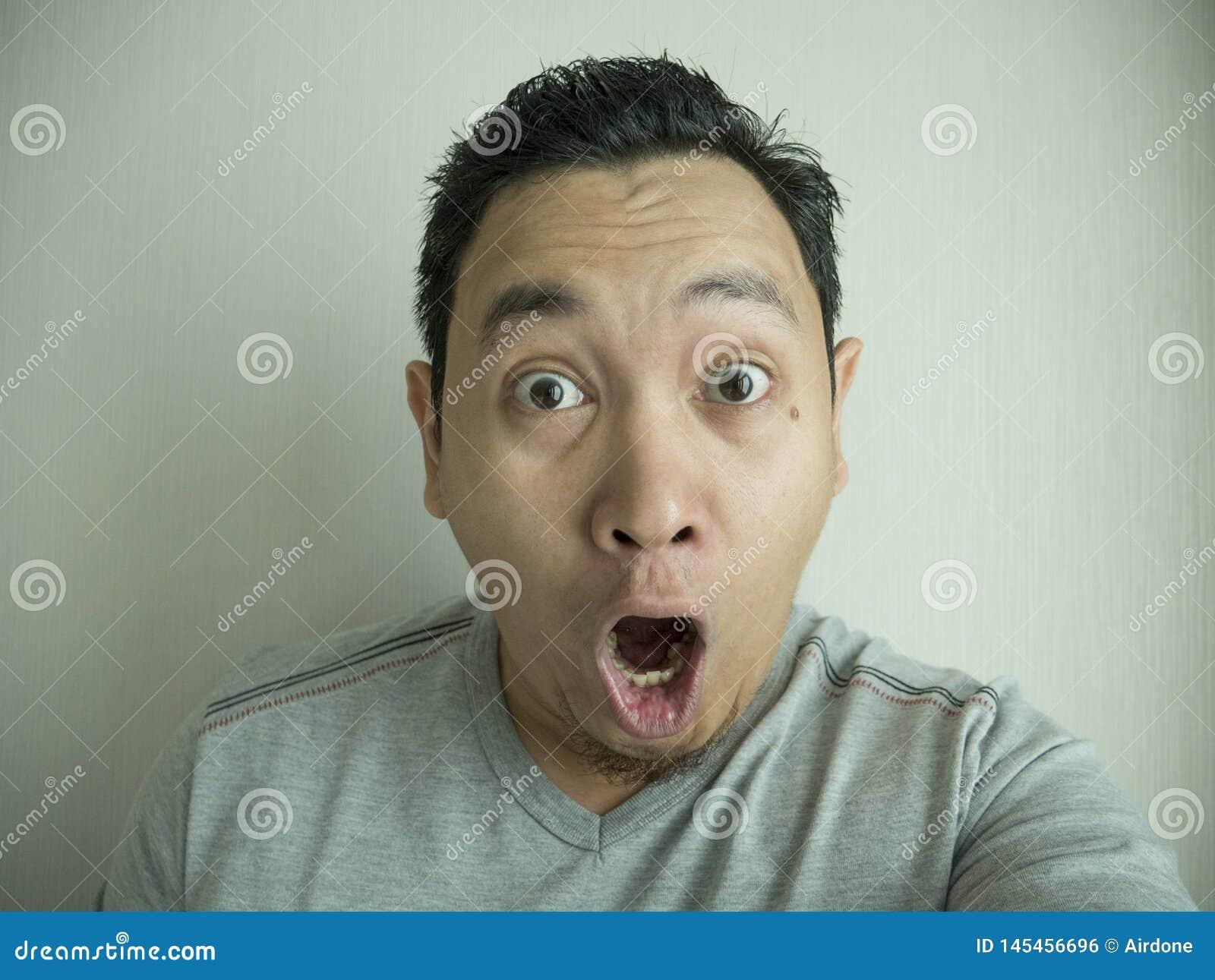 Happy Funny Asian Man Laughing at Camera