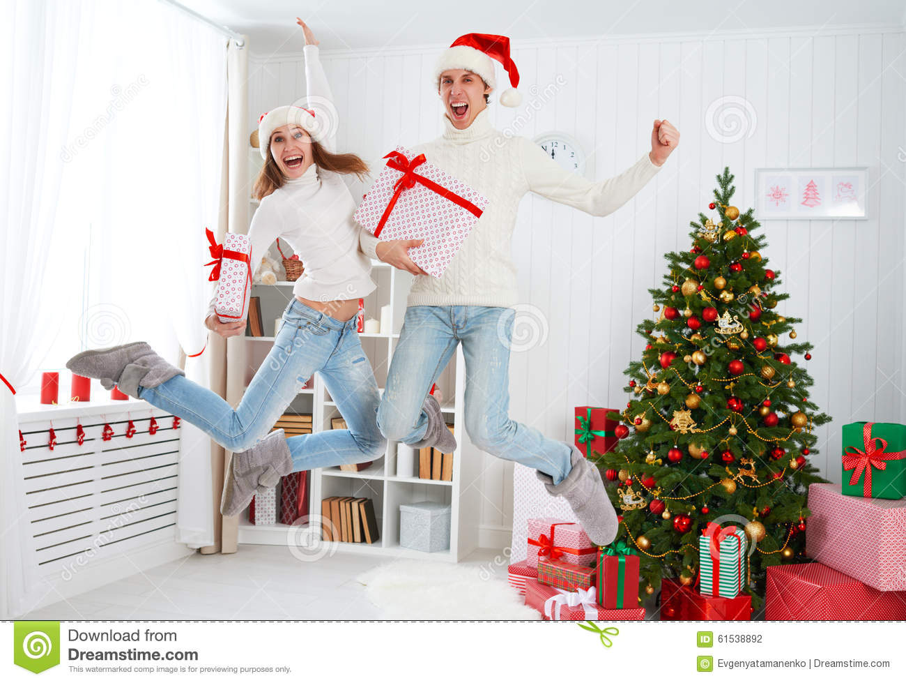 Download Happy Funny Family Couple Jumping And Having Fun On Christmas At Stock Photo