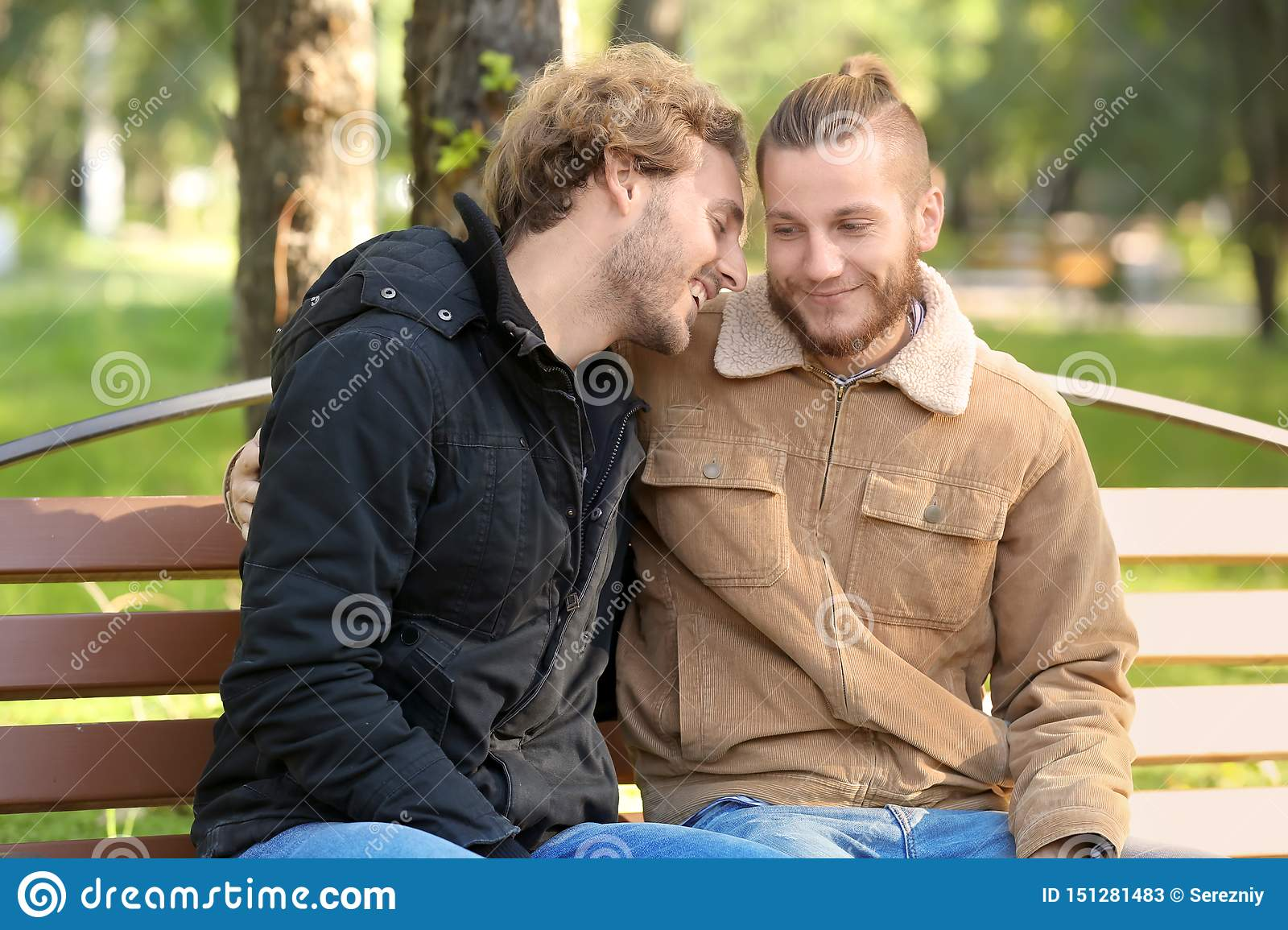 Happy Gay Couple Resting In Park Stock Image - Image of