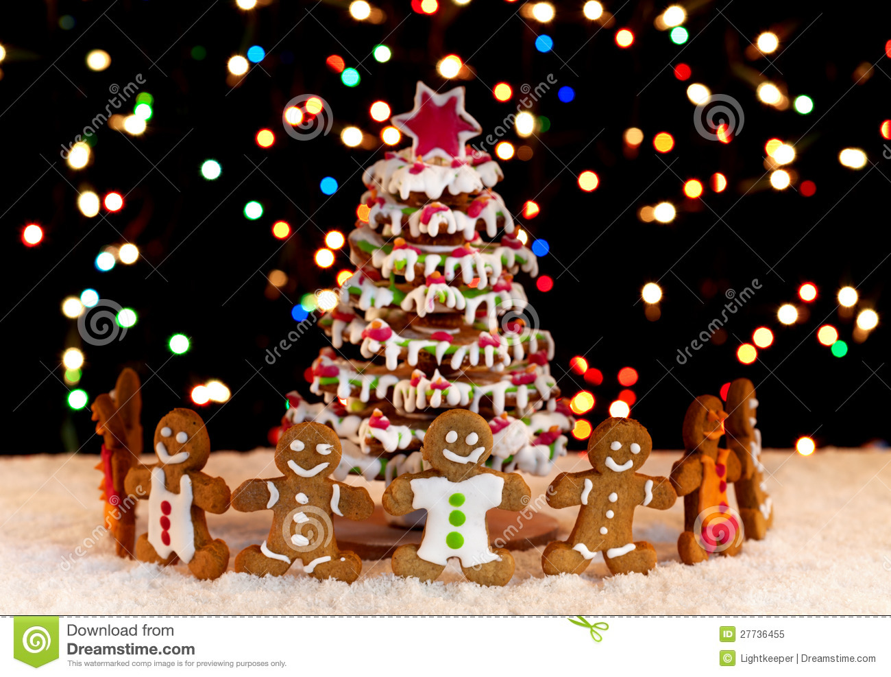Happy gingerbread people around the christmas tree royalty for Around the tree