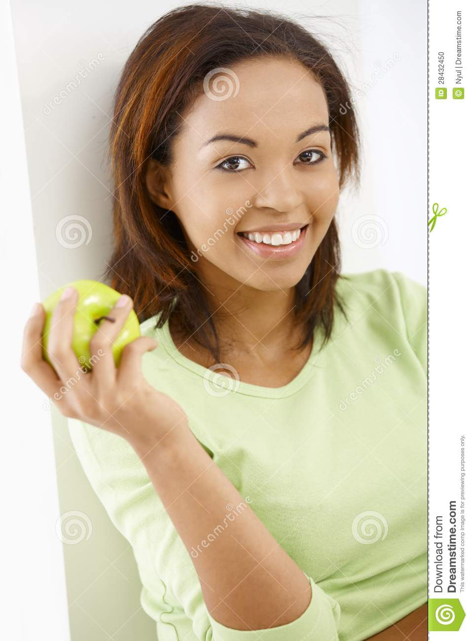 Happy girl with apple