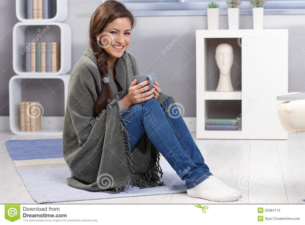 97efa25d8d Happy girl with blanket and tea. Winter portrait of happy girl laughing
