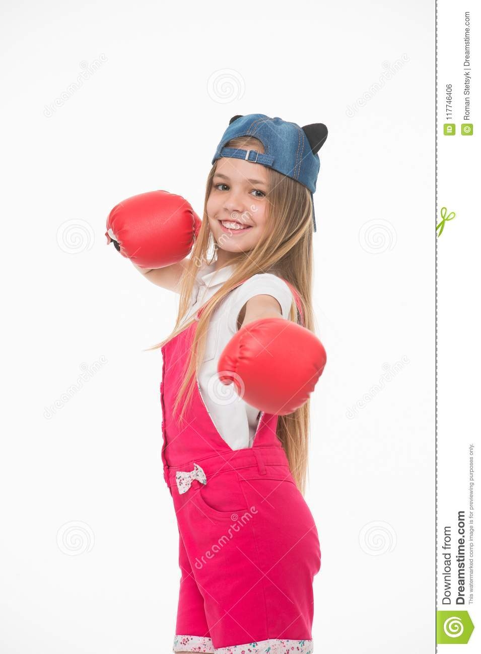 Happy girl in boxing gloves isolated on white. Little child smile before training or workout. Kid athlete in fashionable