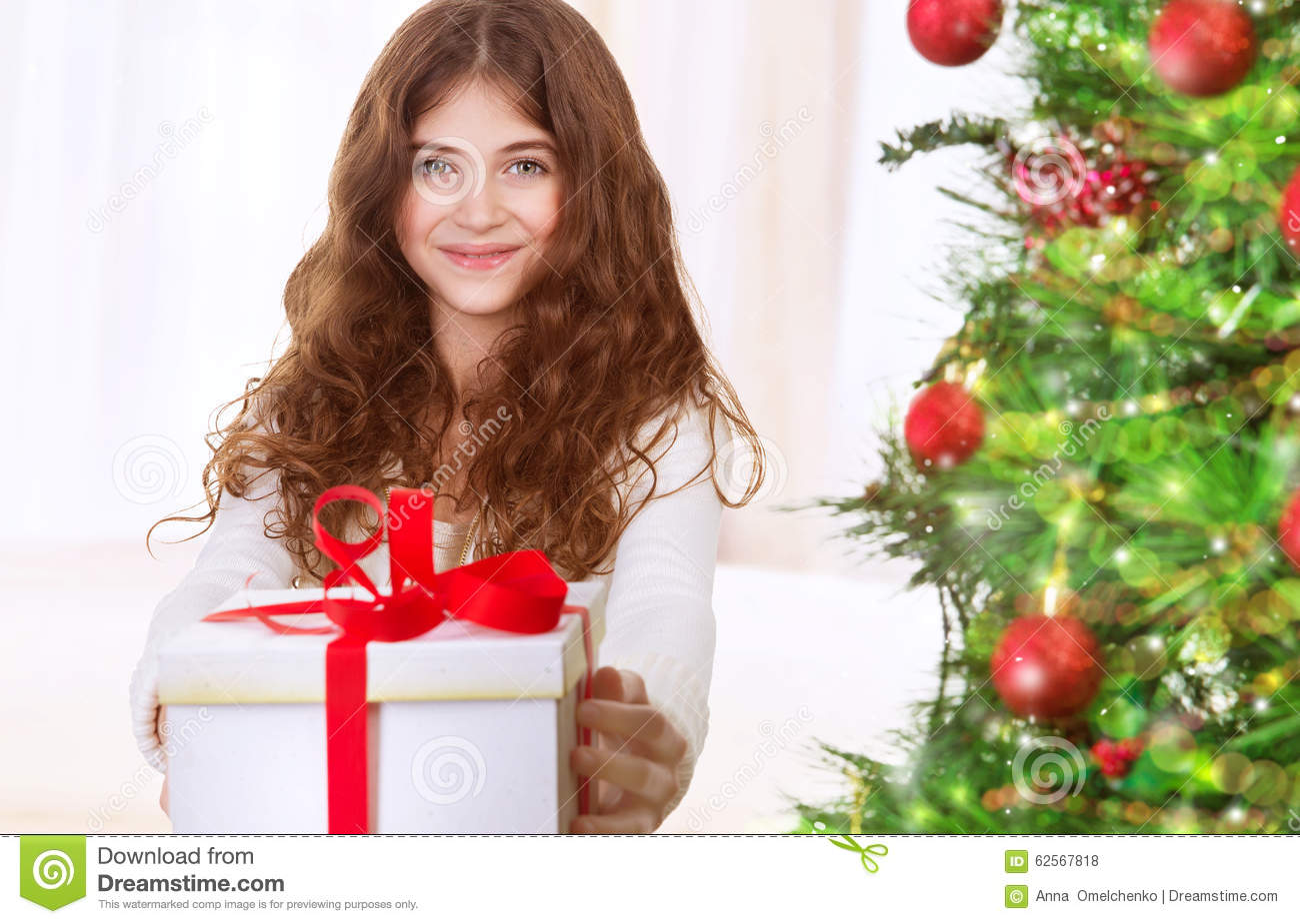 Cute Christmas Gifts For Teenage Girls.Happy Girl With Christmas Gift Stock Photo Image Of Cute
