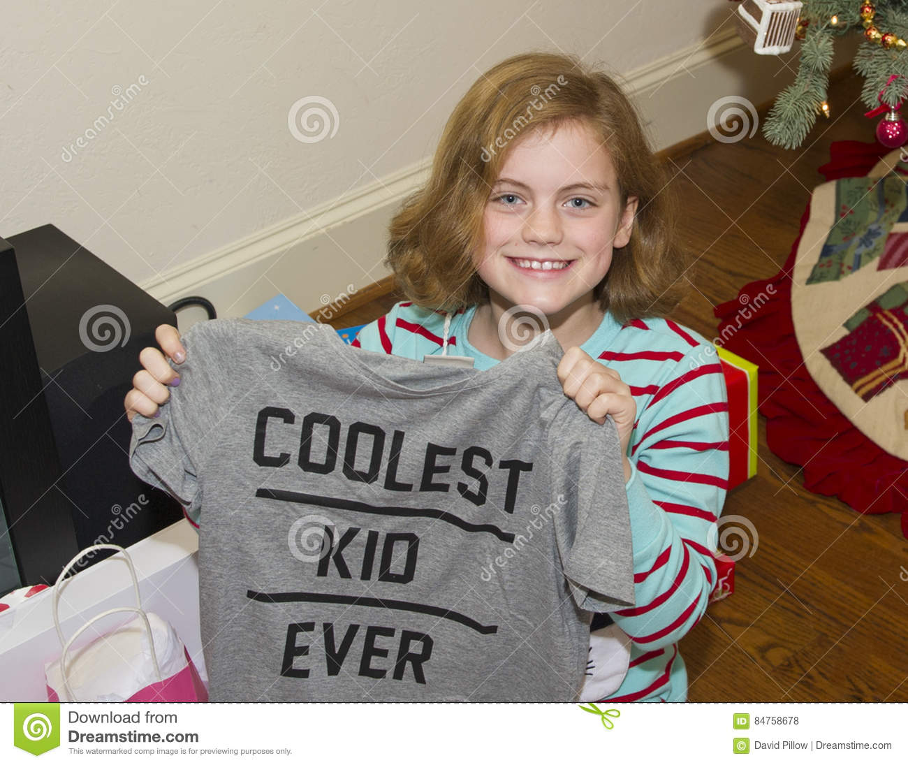 Happy Girl With Christmas Present Stock Photo - Image of length ...