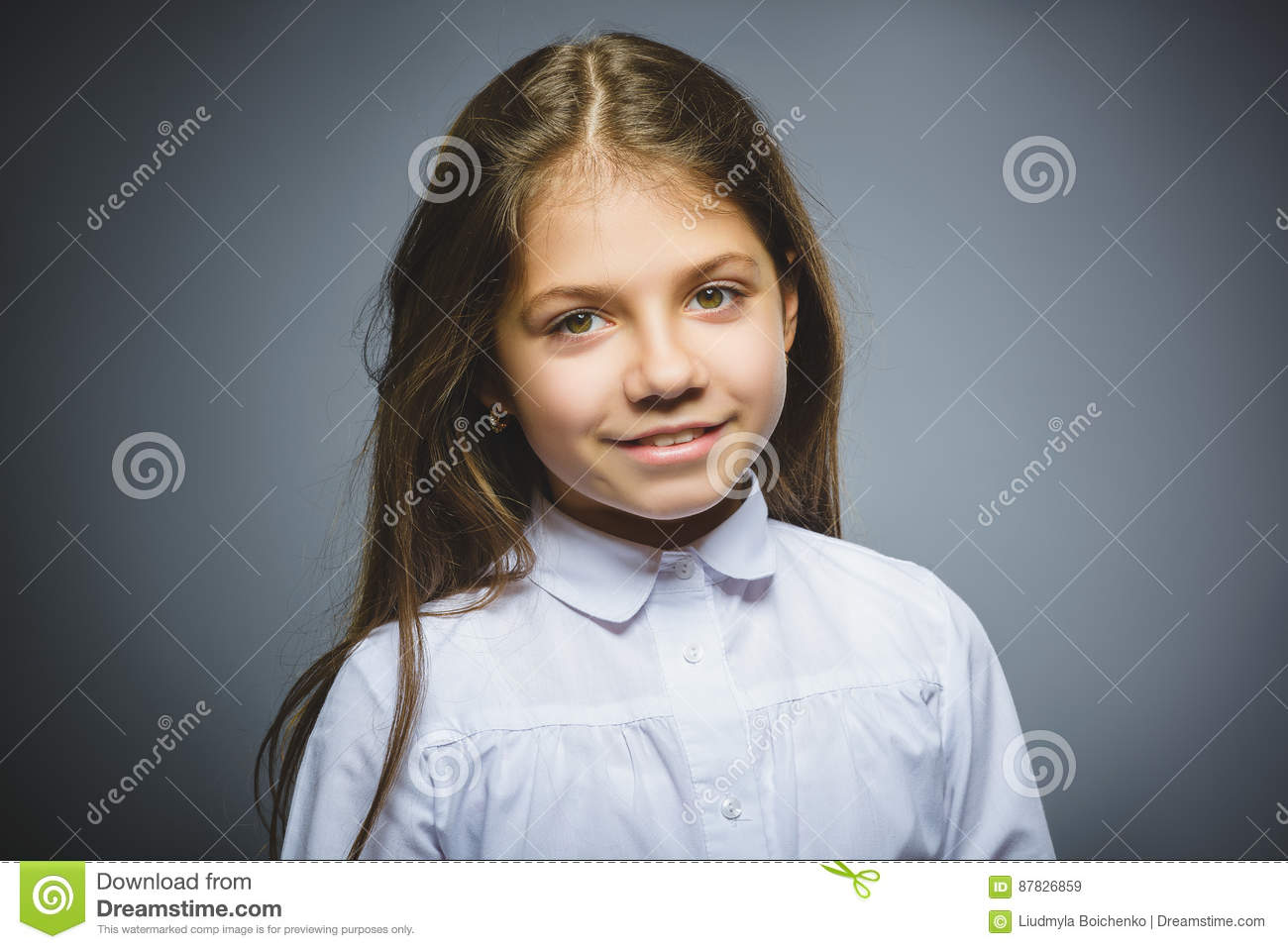 Happy girl. Closeup Portrait handsome child smiling isolated on grey