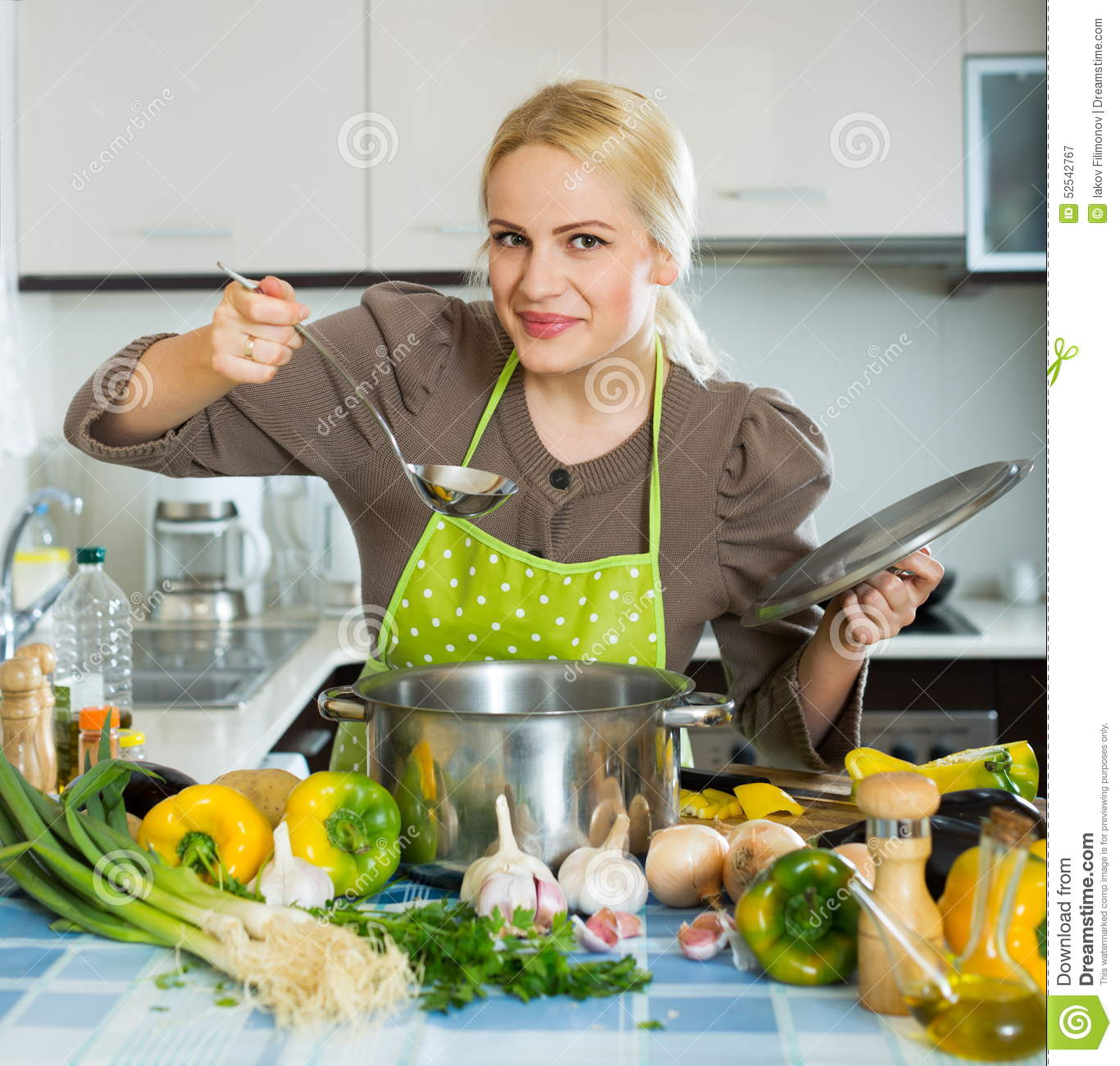 Happy Girl Cooking At Kitchen Stock Photo