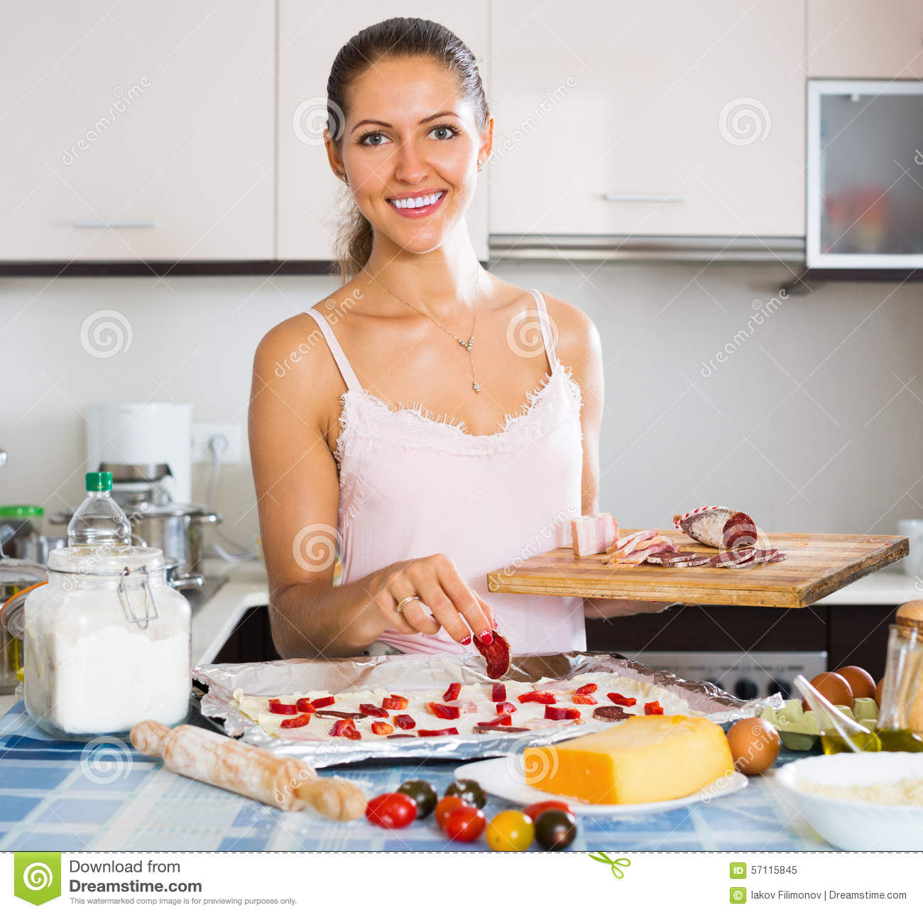 happy girl cooking pizza at home kitchen stock image - image: 57115845