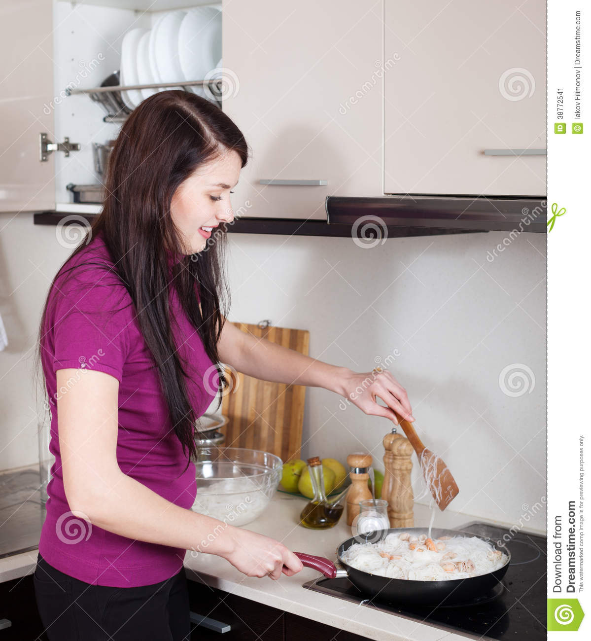 Happy Girl Cooking Rice Noodles With Seafood Stock Image