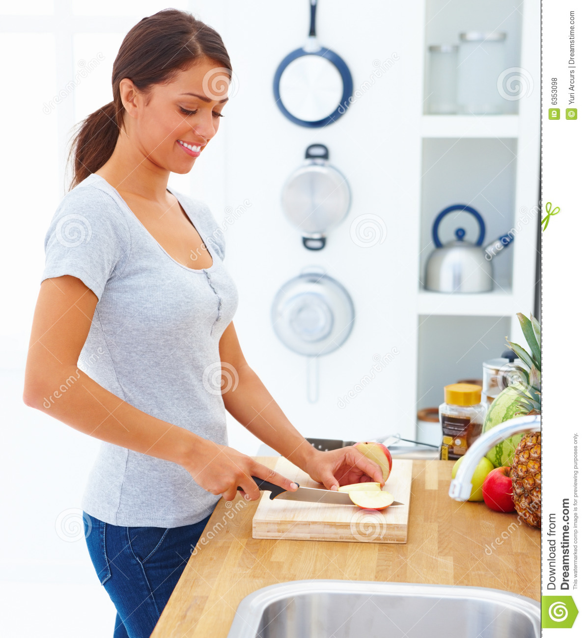 Royalty Free Stock Photos: Happy Girl Cutting Apple In The