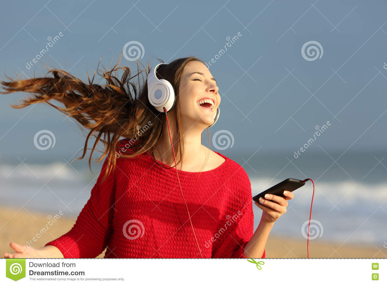 happy girl dancing and listening music stock image image