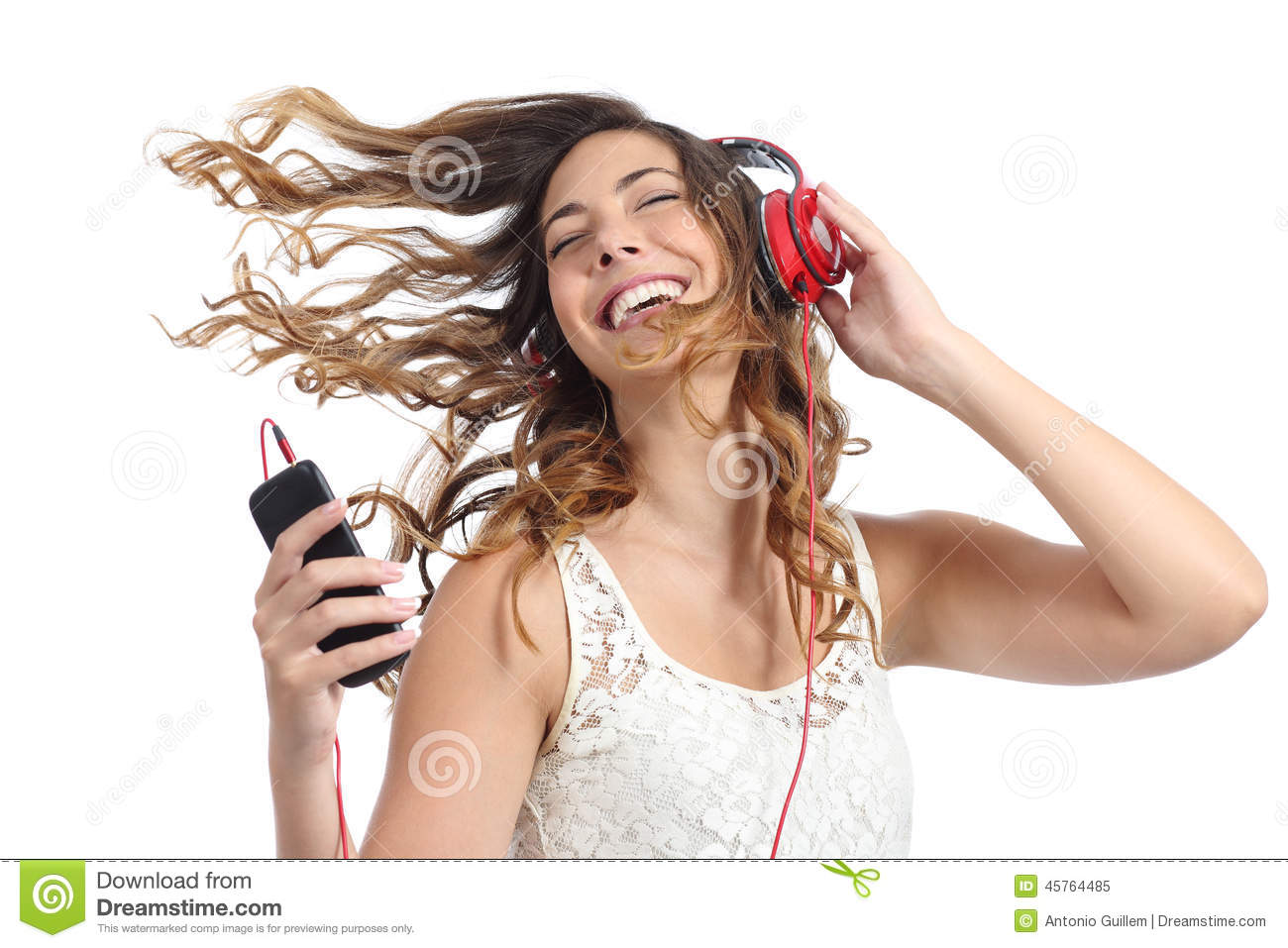 happy girl dancing and listening to the music stock image
