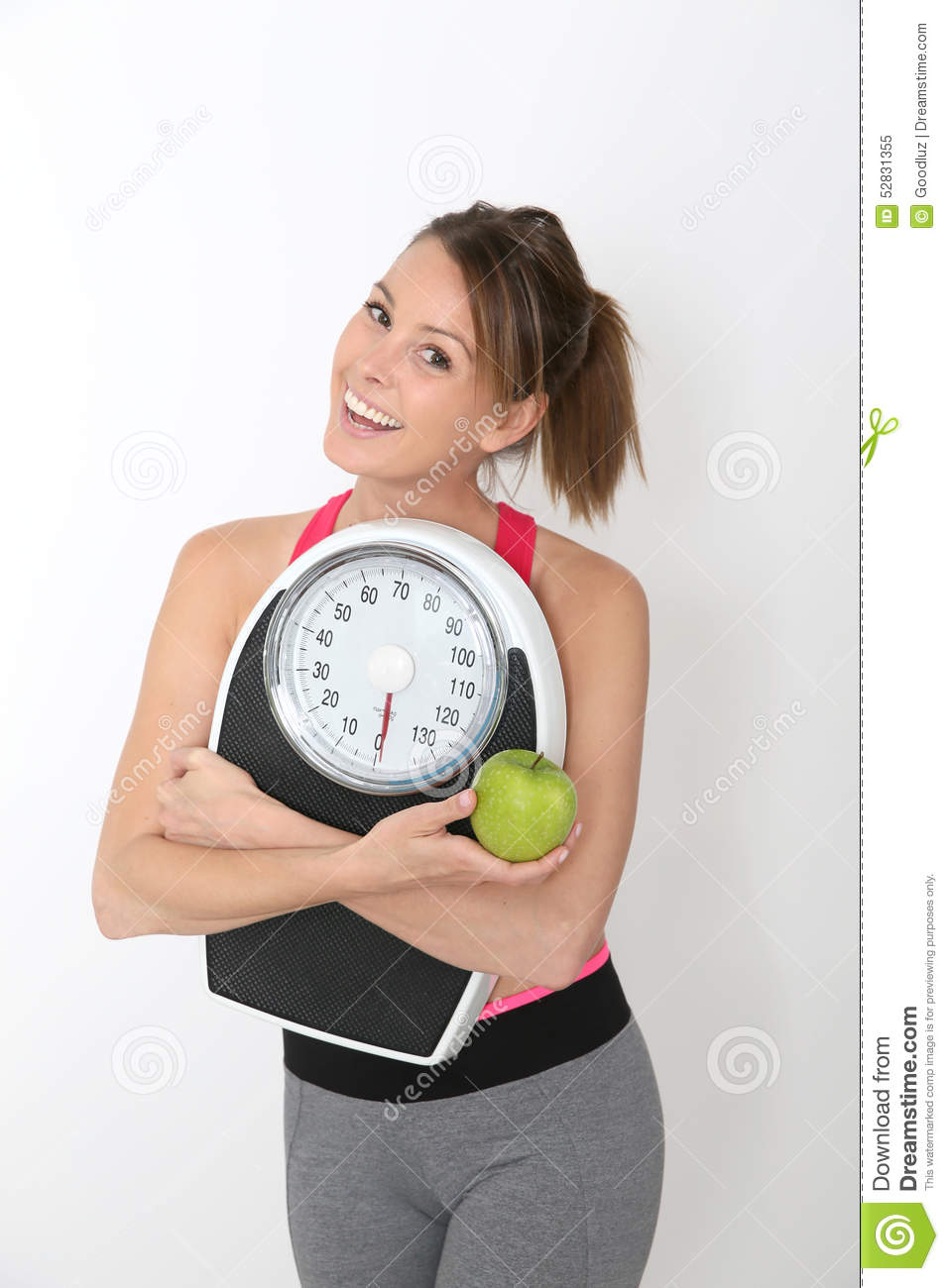 Fitness girl holding weight and apple vector illustration