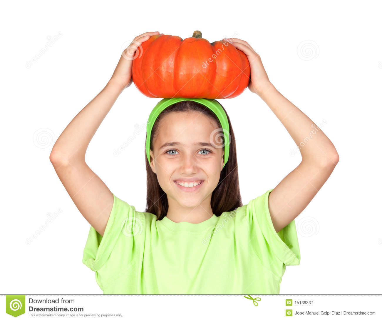 Happy girl in Halloween with a big pumpkin