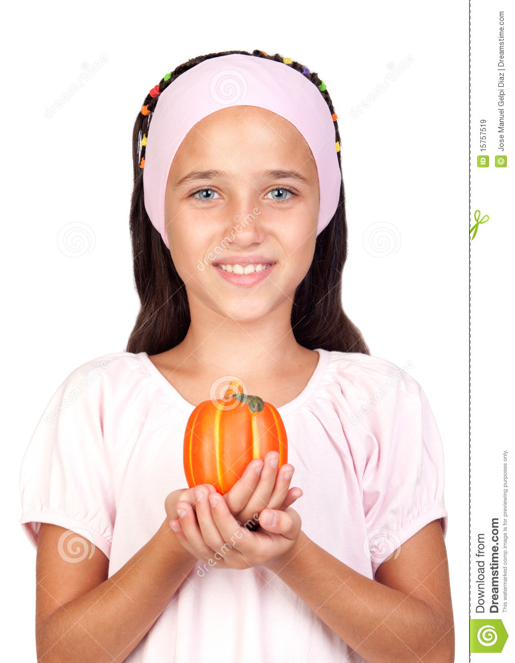 Happy girl in Halloween with a small pumpkin