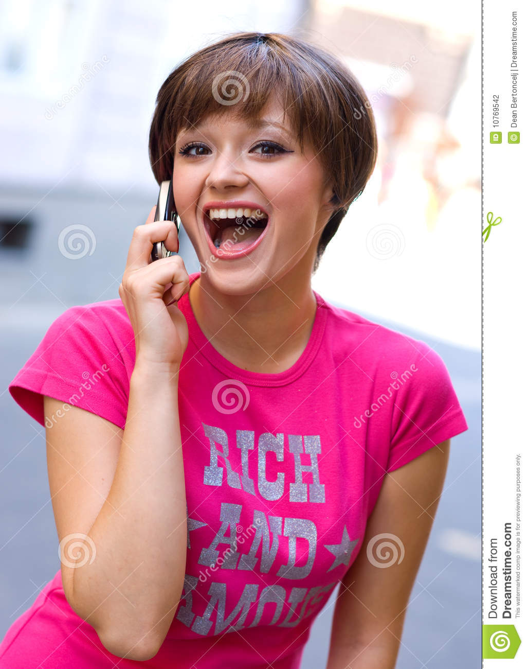 Happy Teen By Crumbling Wall Stock Image: Happy Girl With Mobile Phone Stock Photography