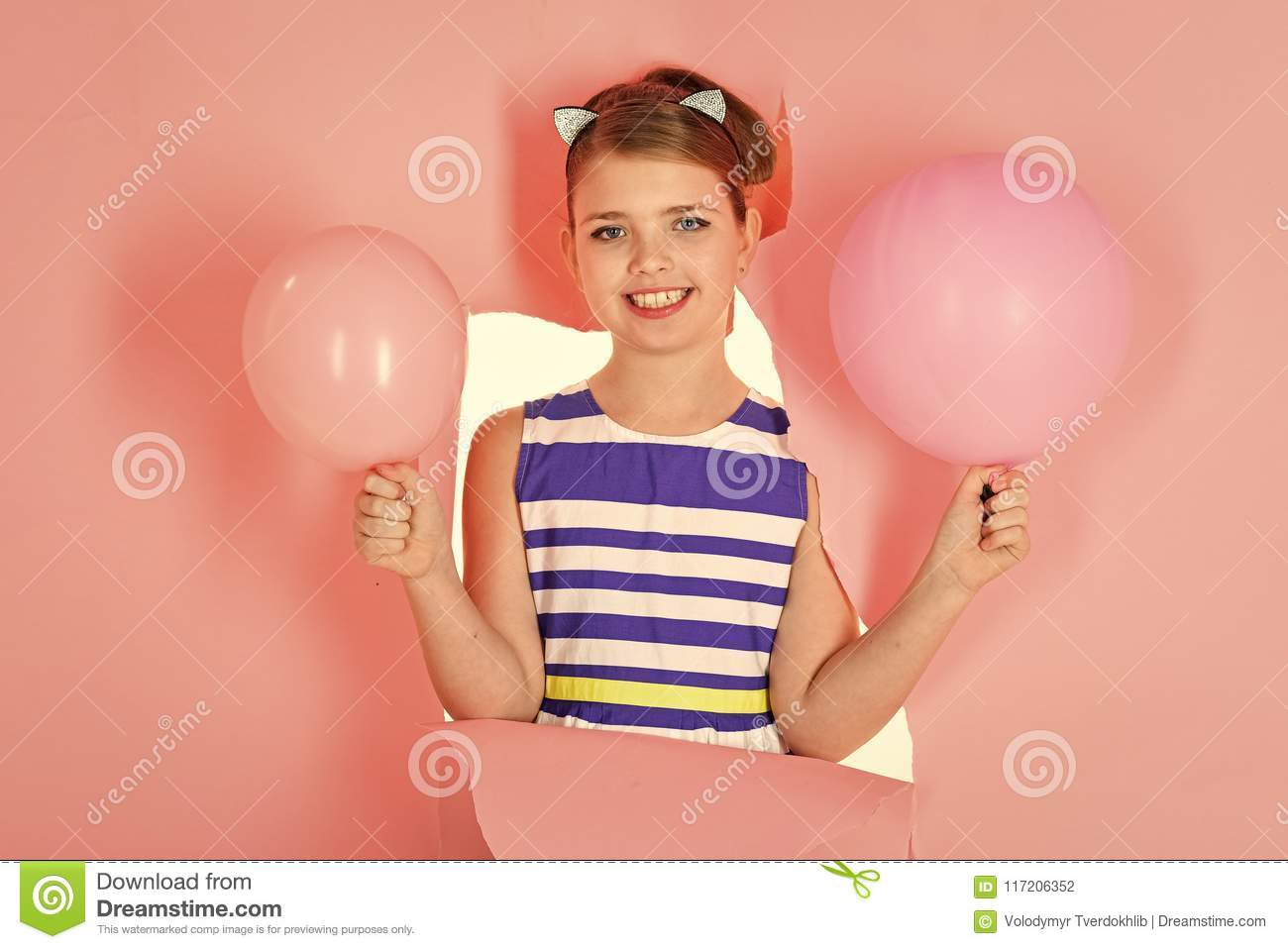 Happy girl play at home. Happy kid having fun. Funny lovely child having fun in children room with balloons