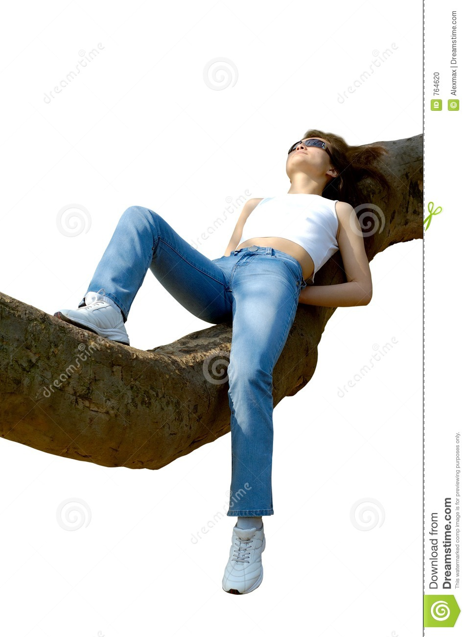 Happy girl relaxing outdoors on tree branch isolated