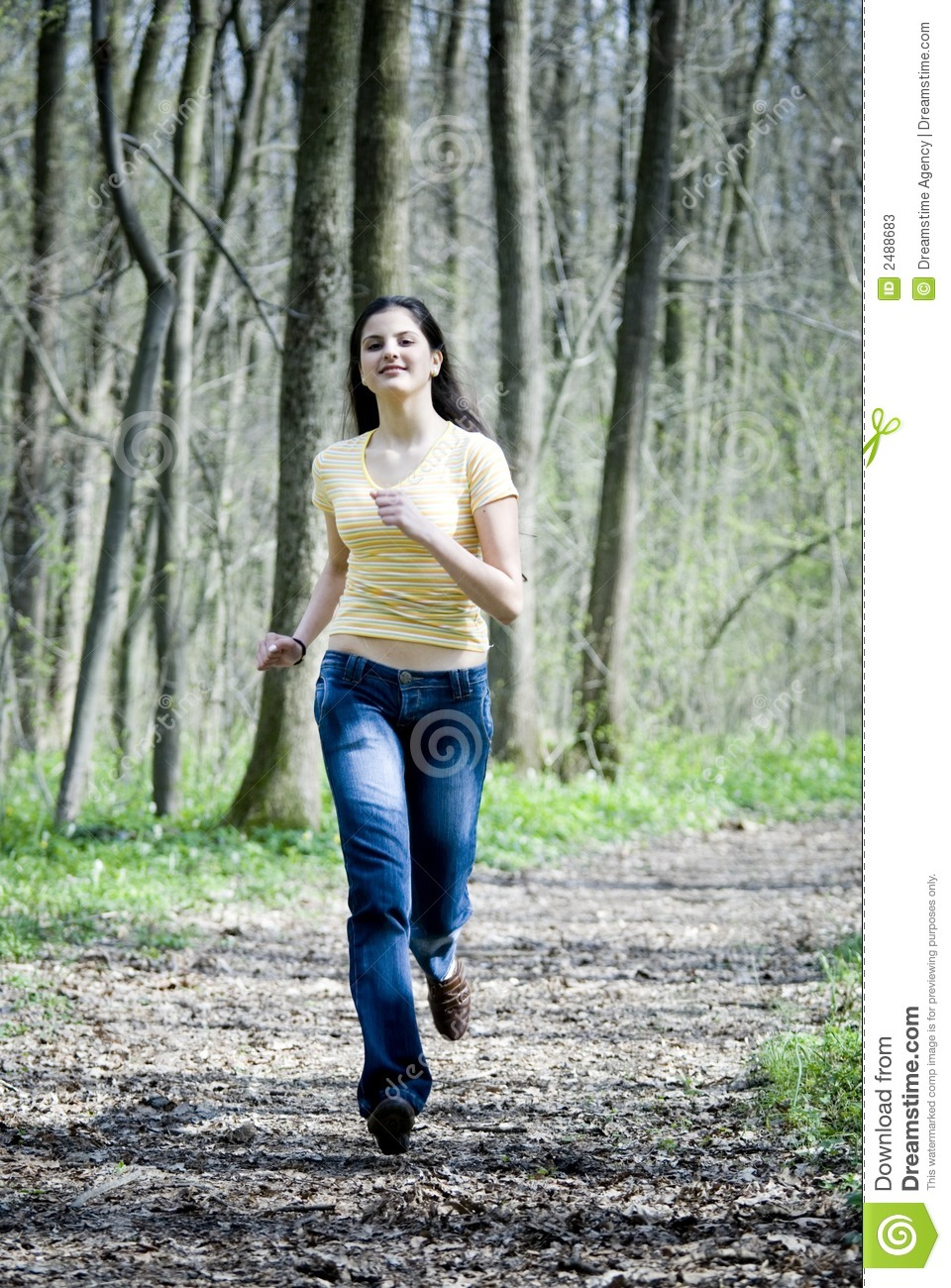 Happy Girl Running In ... Dark Path In The Woods