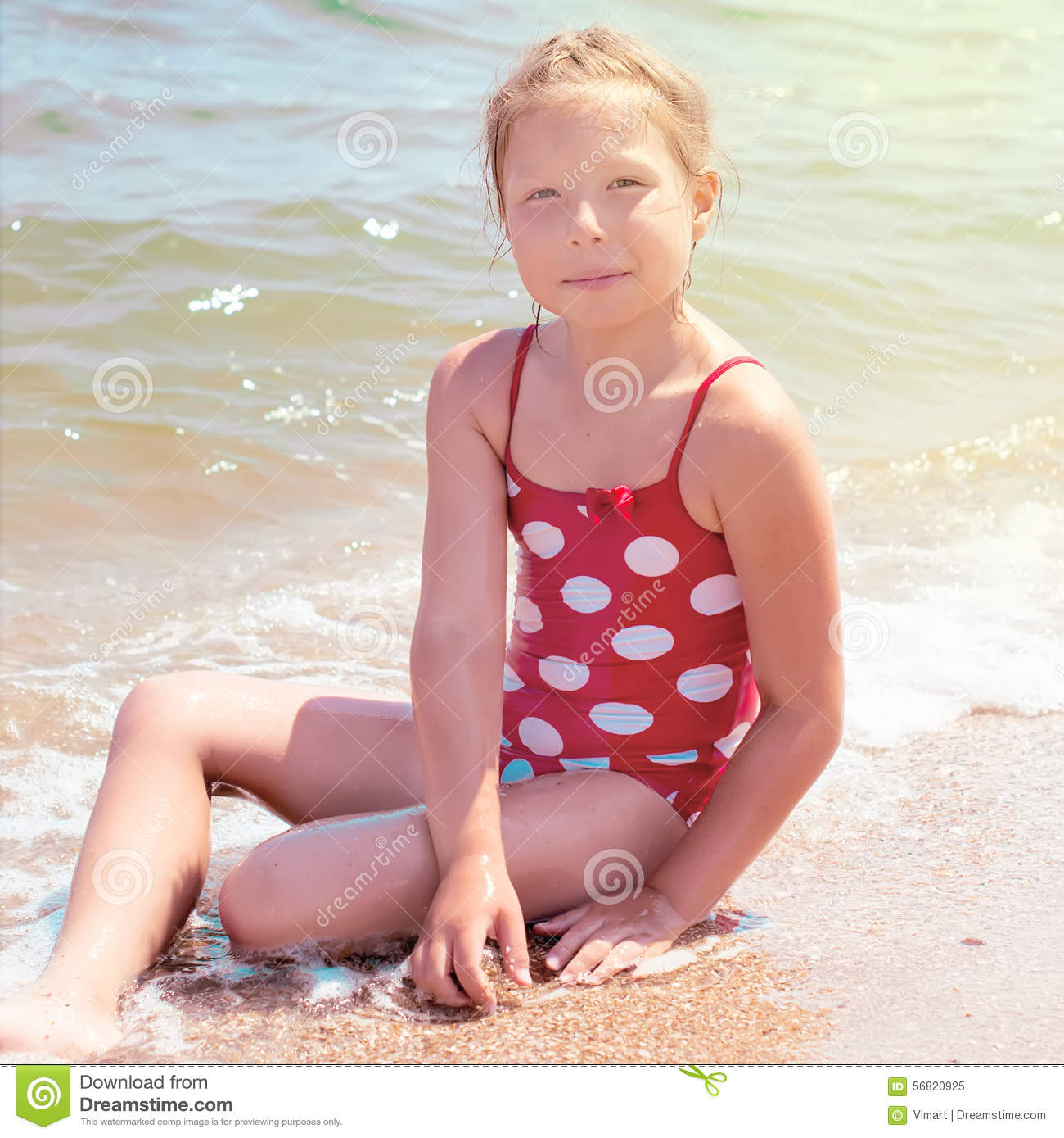 Adorable Little Girl Playing With Beach Toys During: Happy Girl At Sea Beach Stock Image. Image Of Beach