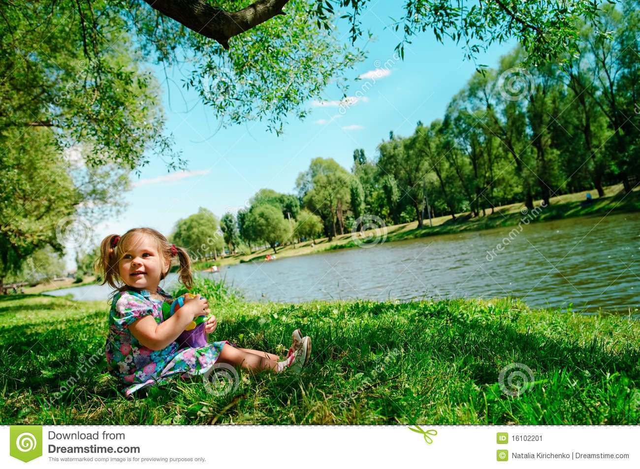 Happy Girl Sitting On River Bank Stock Image - Image: 16102201