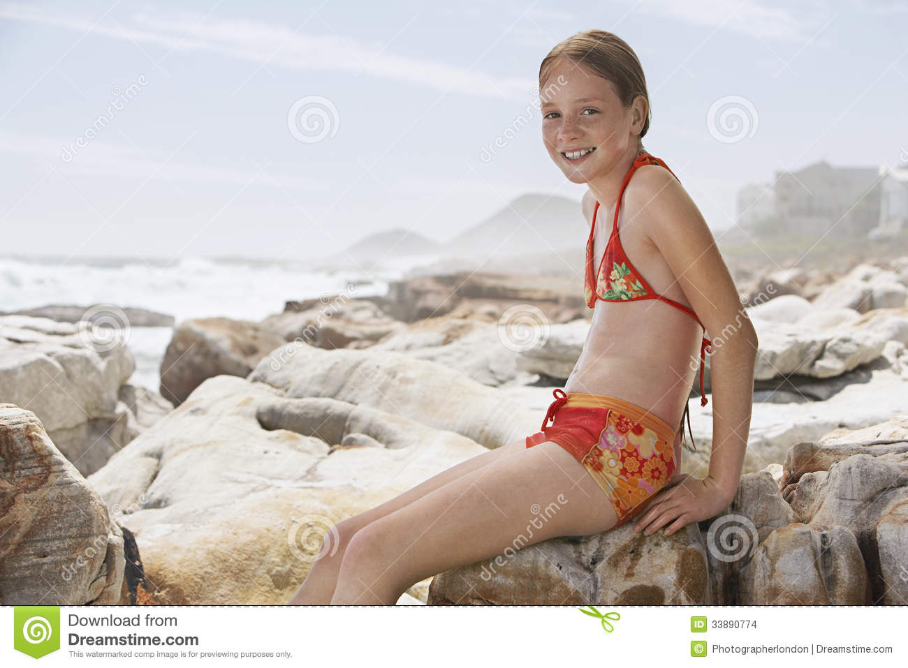 Name girl sitting on rock
