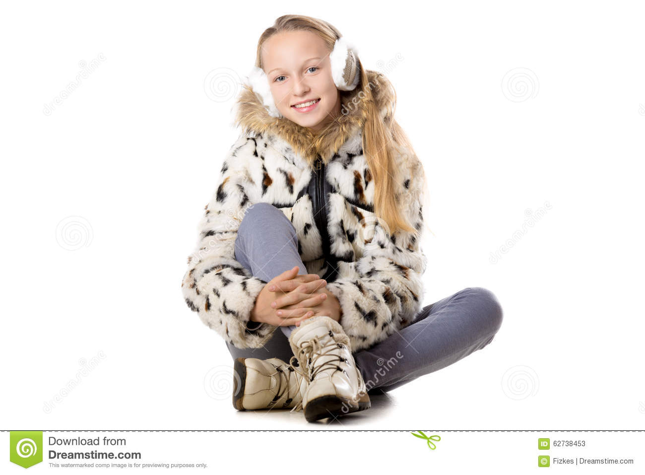 8f68524458 Portrait of happy funny beautiful casual teenage girl wearing winter coat  and earmuffs
