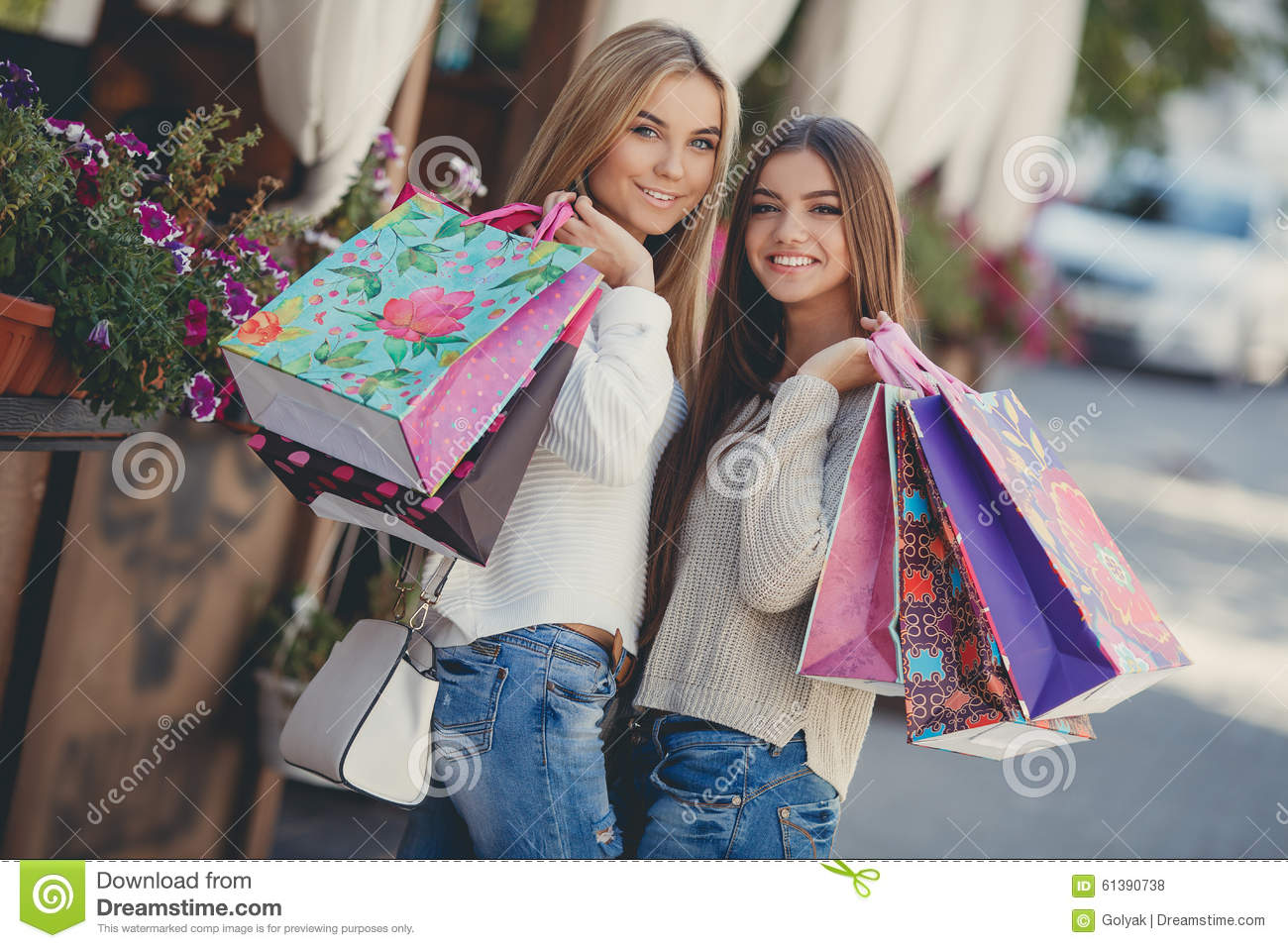 Happy Girlfriends Go Shopping At The Mall