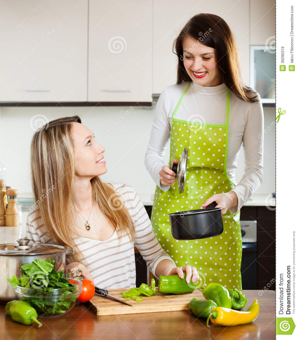 Happy Girls Cooking Together At Domestic Kitchen Stock