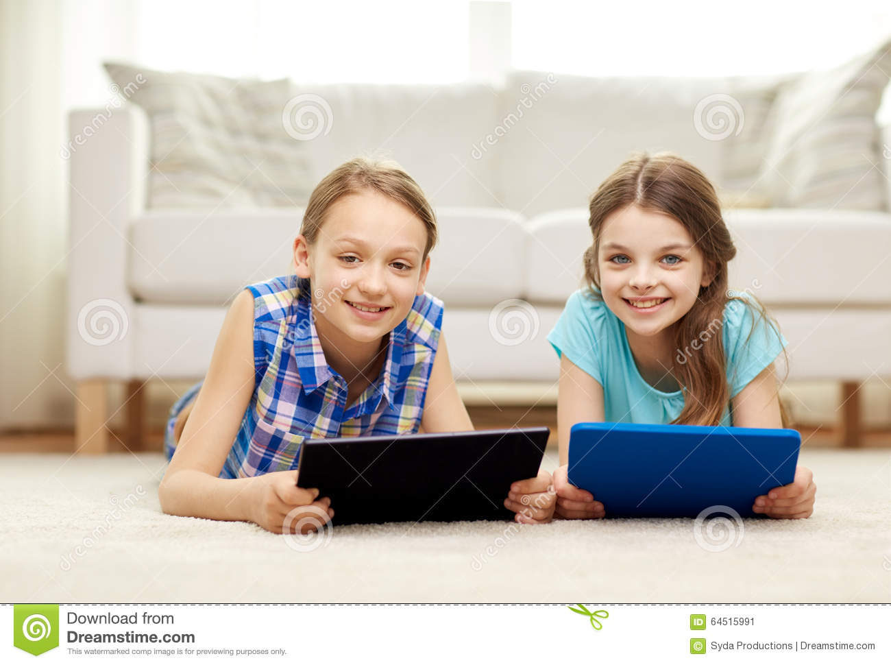 Happy Girls With Tablet Pc Lying On Floor At Home Stock