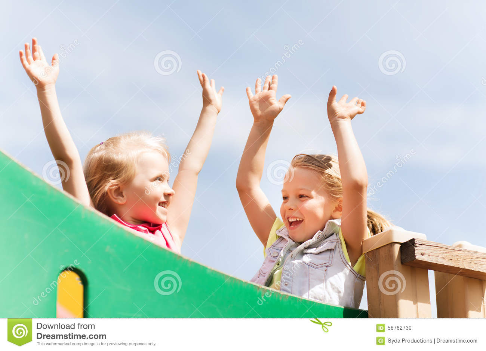Happy Girls Waving Hands On Children Playground Stock ...