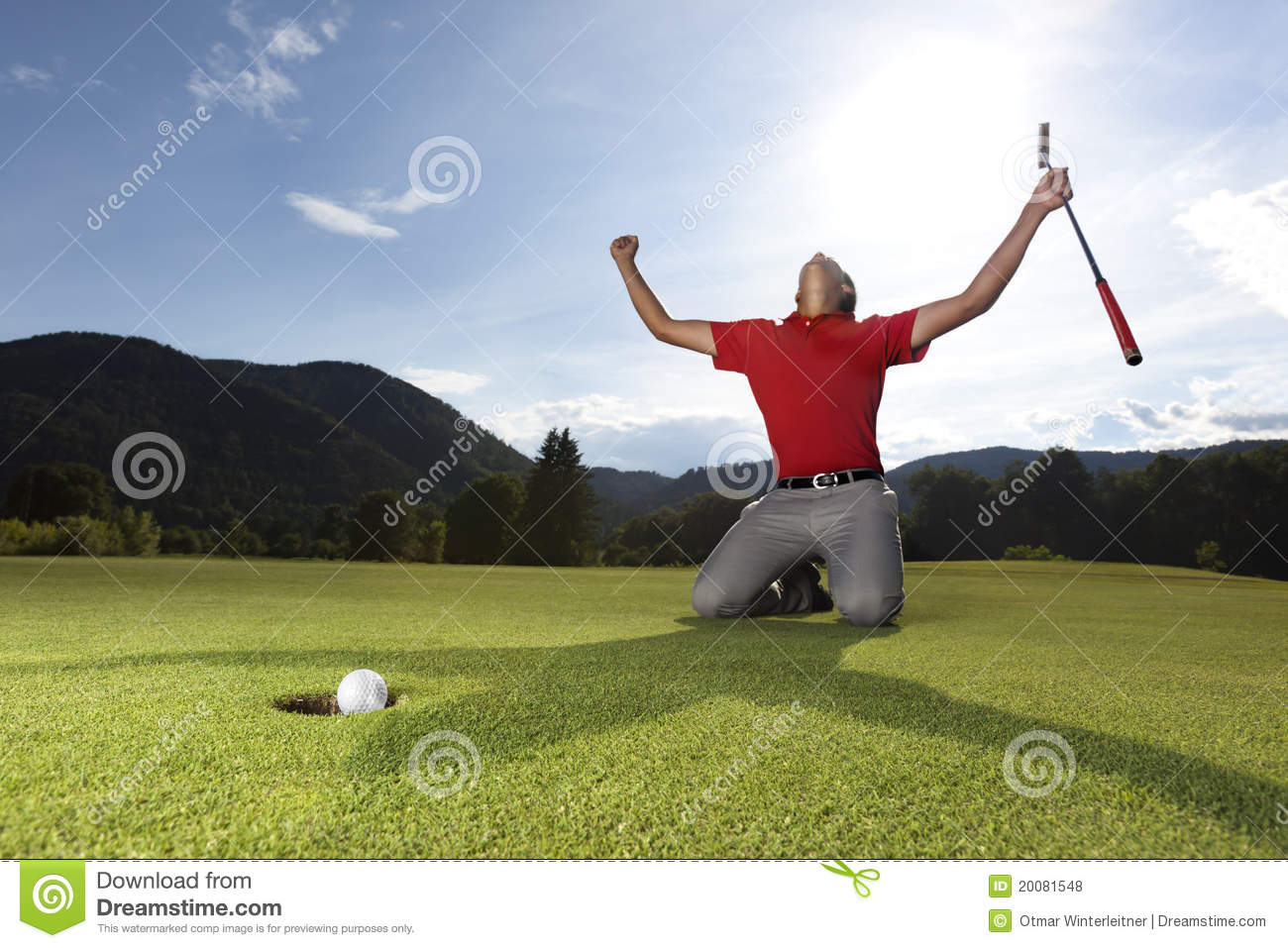 ... in hand on golf green being overjoyed as golf ball drops into cup