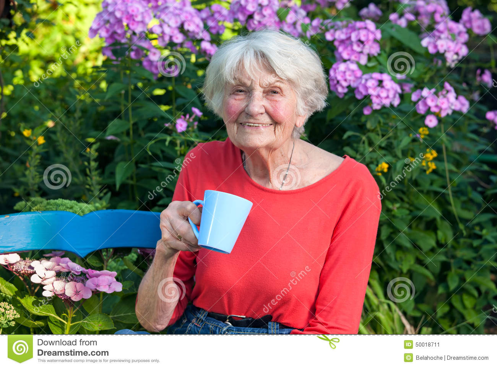 Happy Grandma Having A Coffee At The Garden