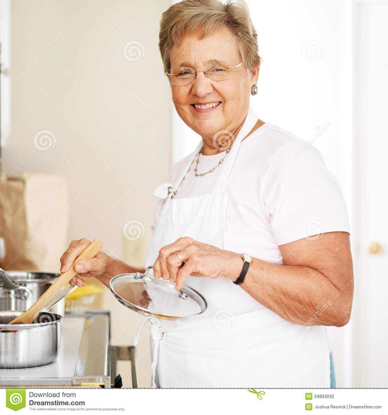 Happy Grandmother Cooking In Kitchen Stock Photo - Image of glasses ...