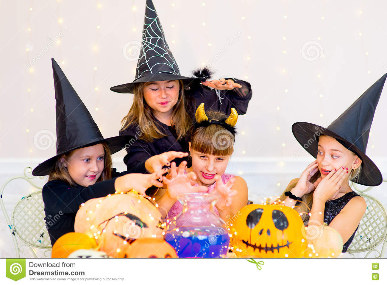 Happy Group Of Teenagers In Costumes During Halloween Party Stock ...