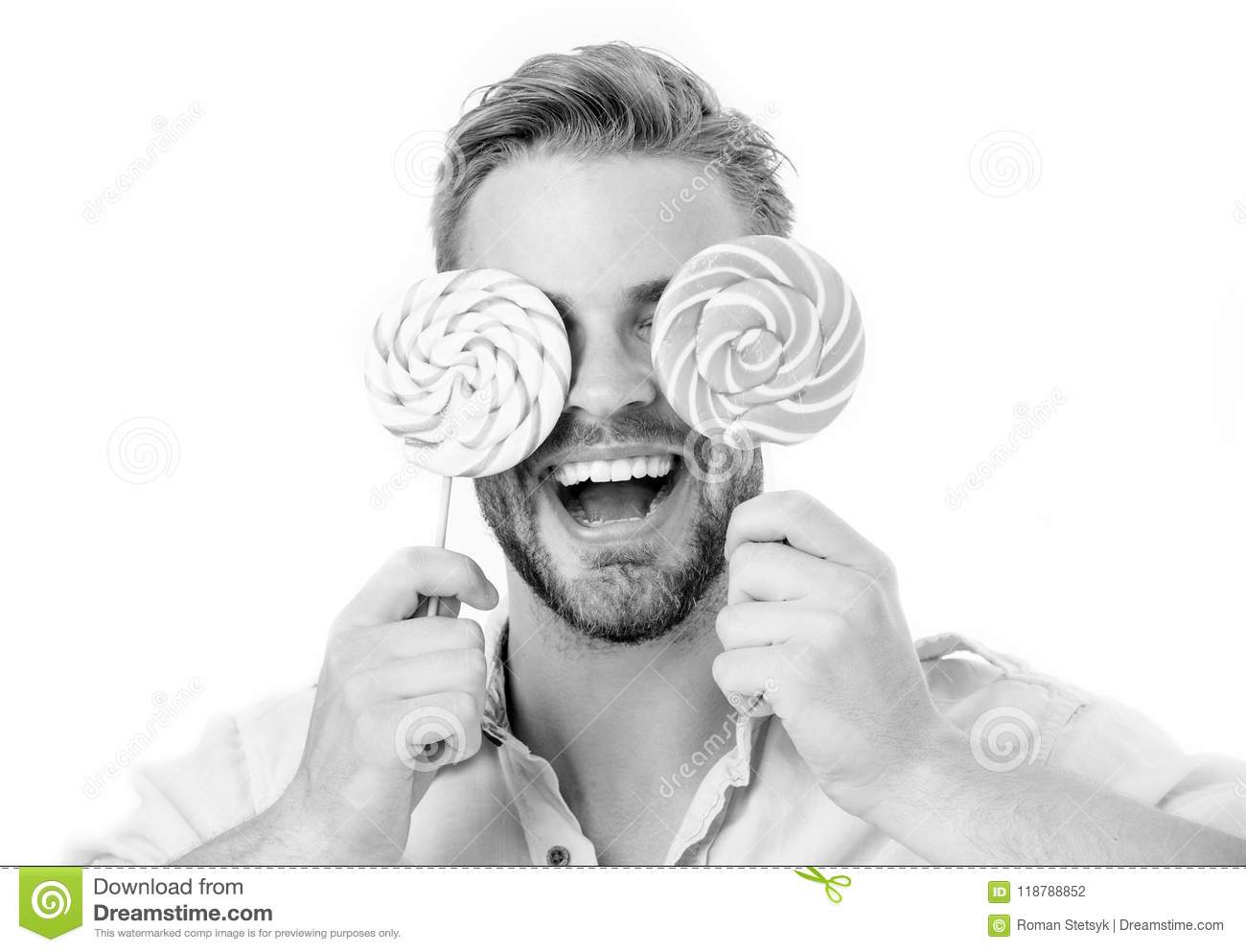 Happy guy with candy glasses isolated on white background. Man smile with lollipop on sticks. Summer. Food and snack