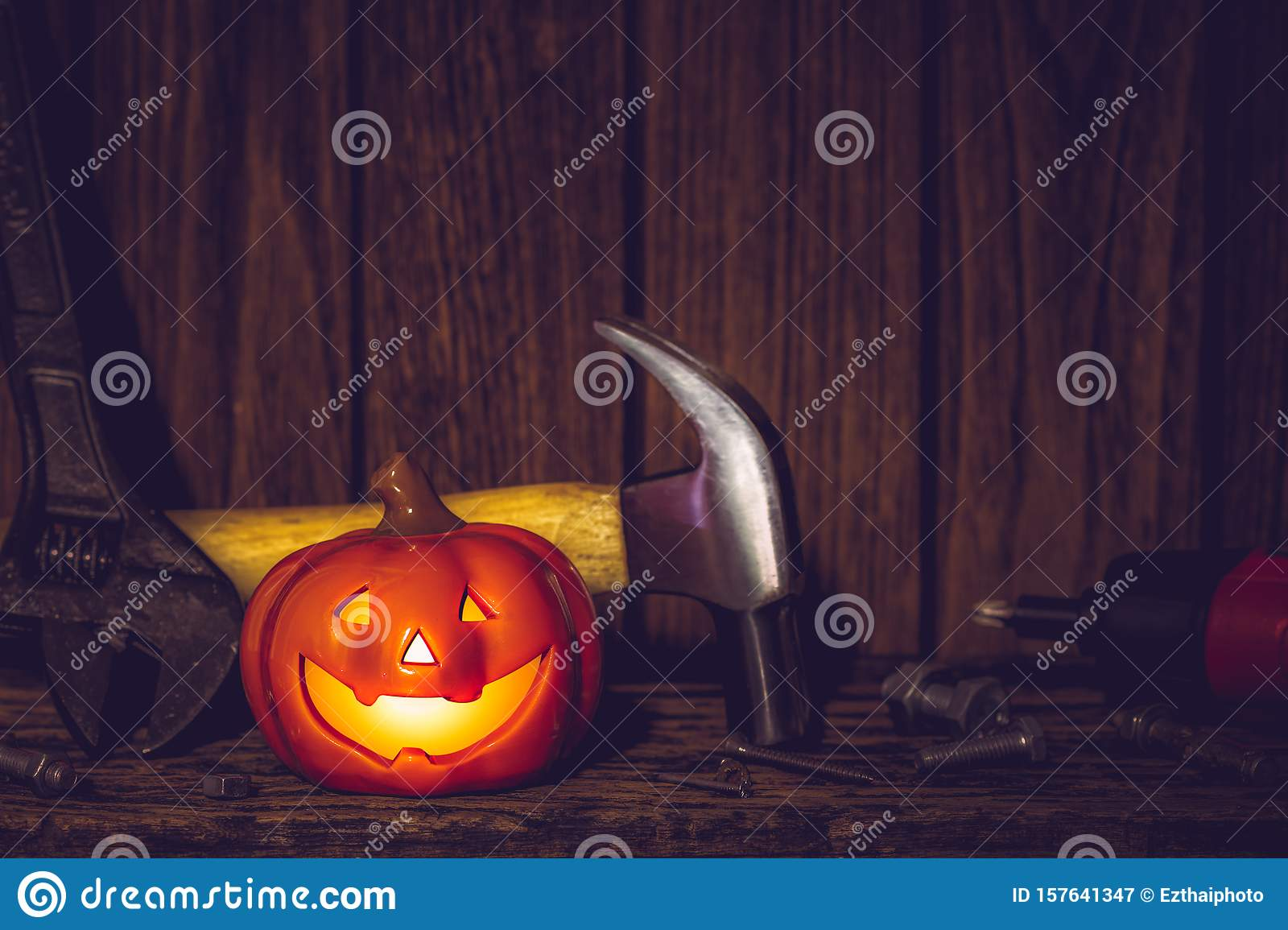 Happy Halloween day with construction tools and home DIY handy tools on rusty wooden background concept with copy space
