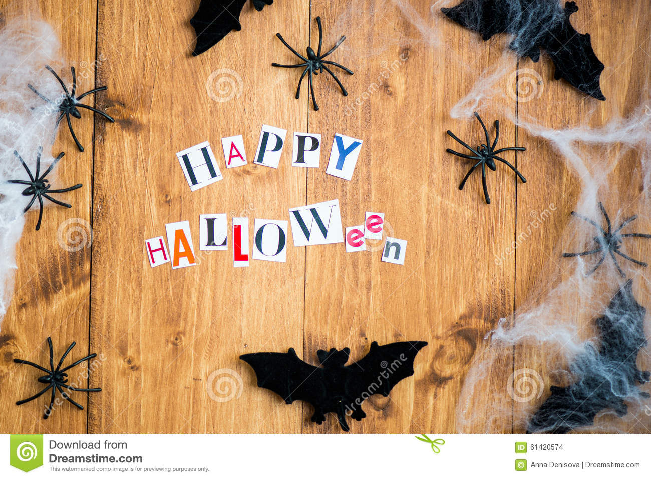 happy halloween letters cut out from the magazines, bats, web an