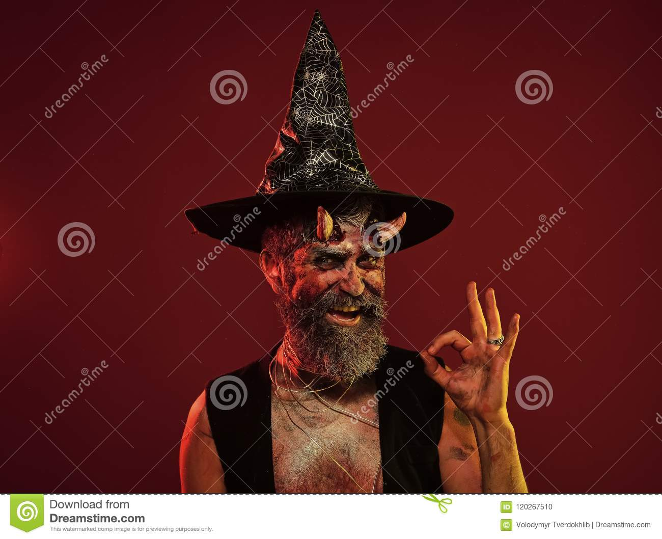 Halloween Maan.Happy Halloween Man With Devil Horns In Witch Hat Show Ok