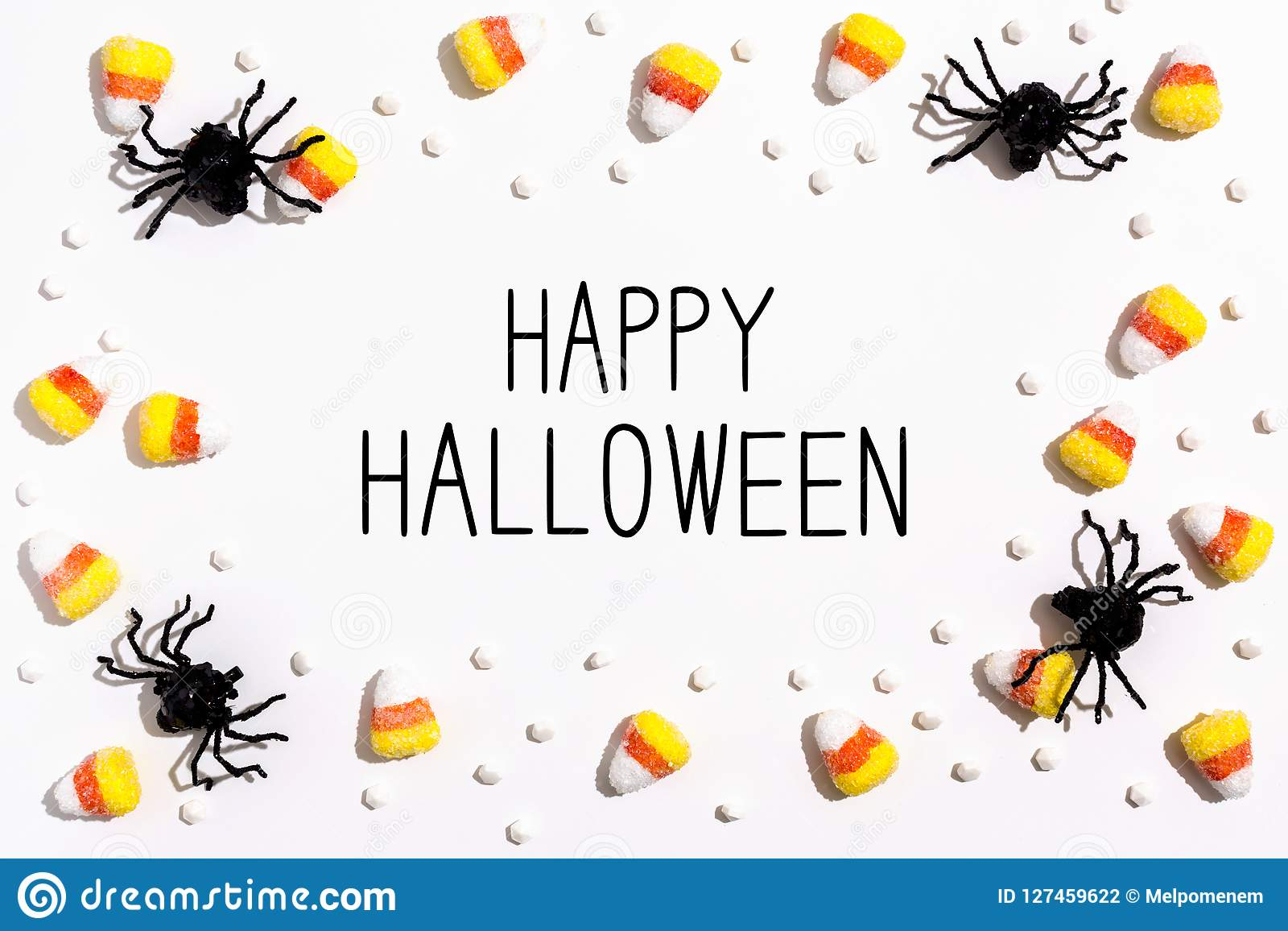Happy Halloween message with spiders overhead view