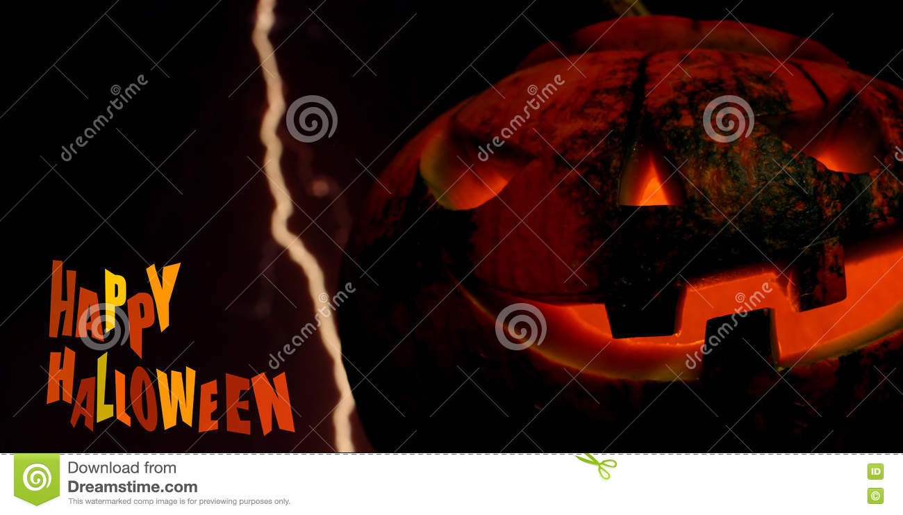 happy halloween pumpkin card background with lightning stock photo