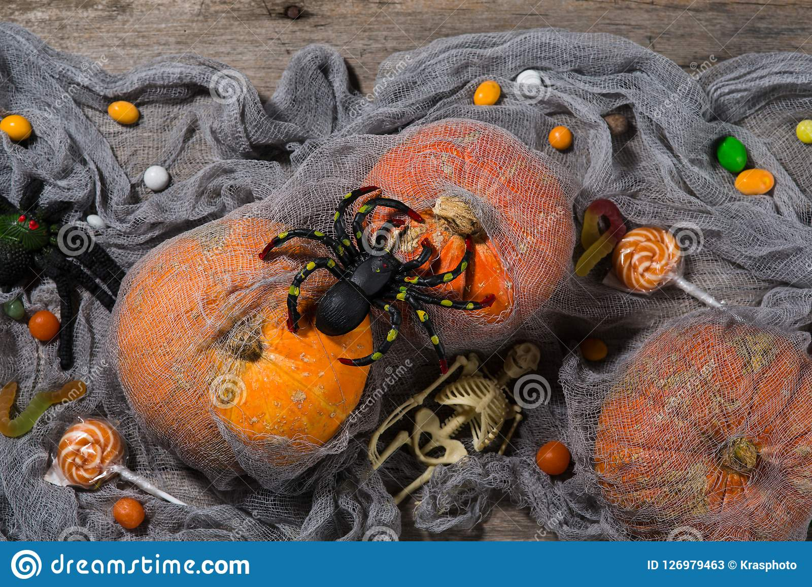 halloween pumpkins, spiders, horror stories and more on a wooden