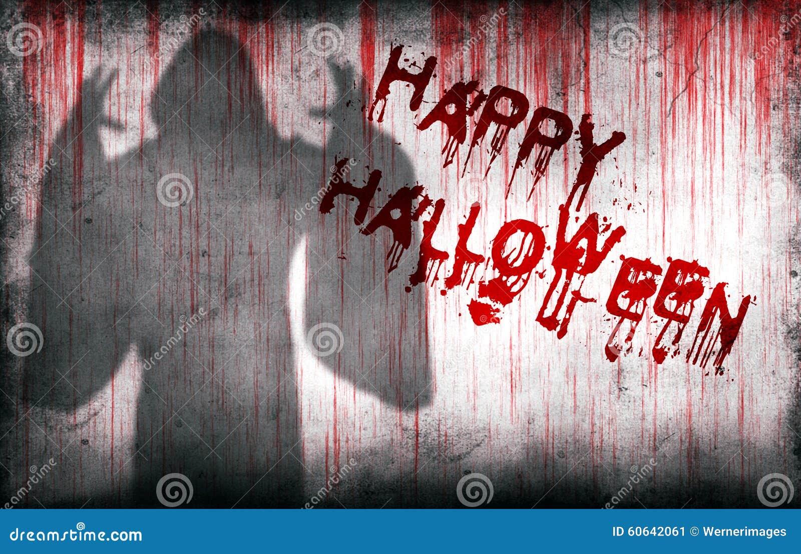 Happy Halloween sprayed on wall next ghostly shadow
