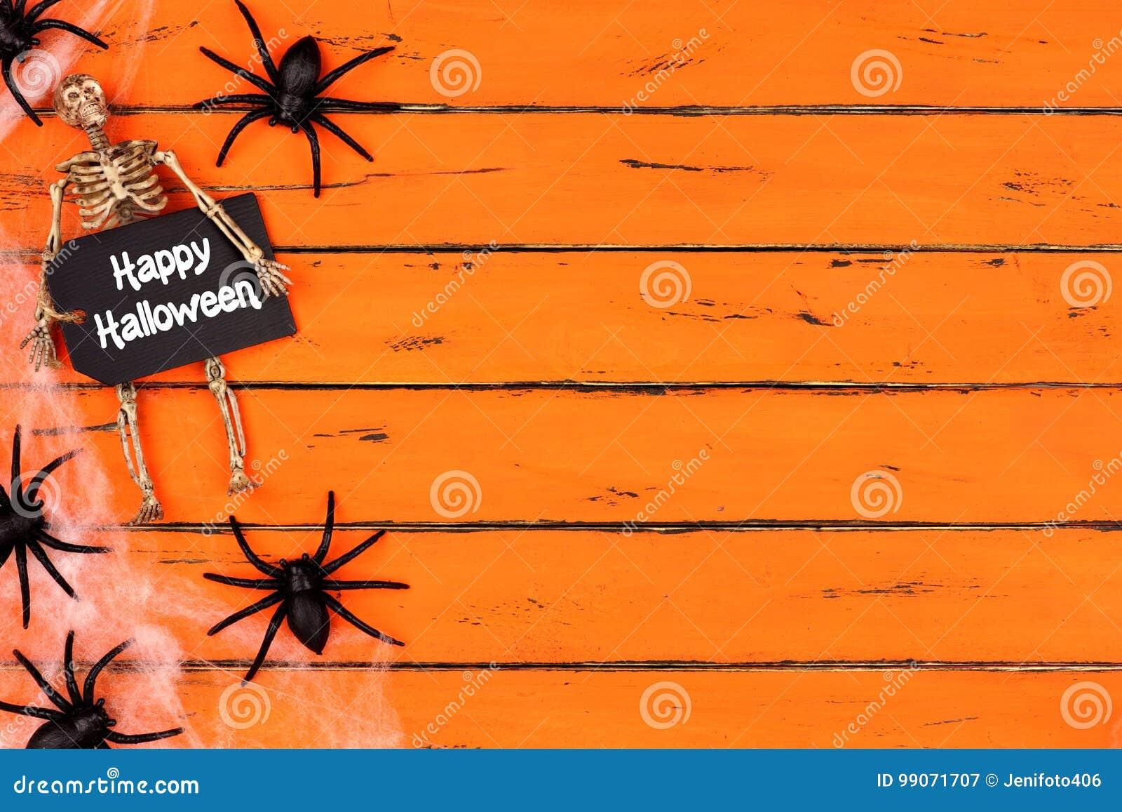 Happy Halloween tag with spider web side border on orange wood