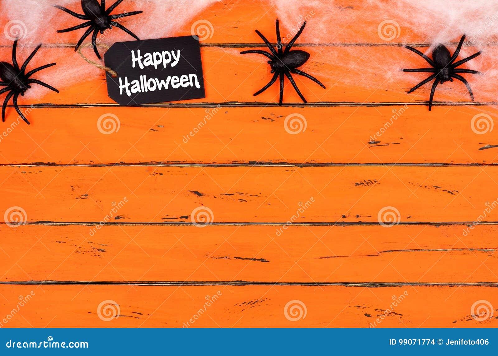 Happy Halloween tag with spider web top border on orange wood